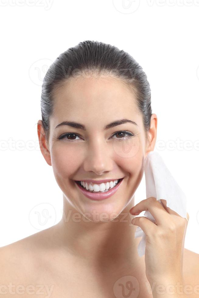 Beautiful woman cleaning face with a facial wipe photo