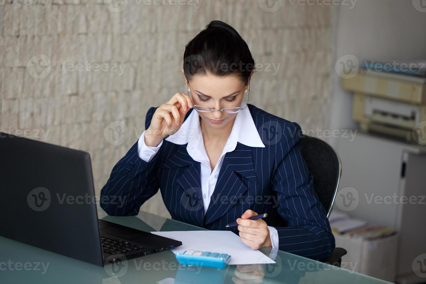 Entrepreneur calculating expenses photo