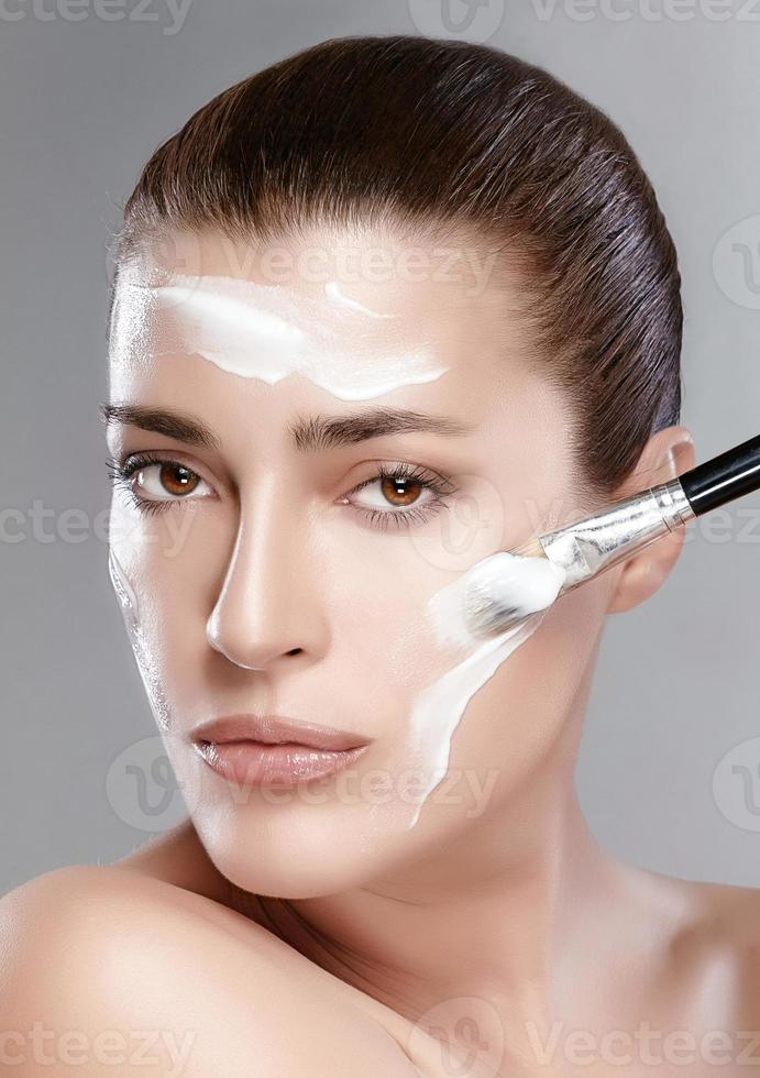 Spa Girl with Cream on Her Face. Skincare concept photo