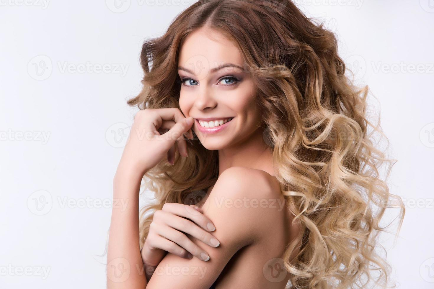 Portrait of beautiful young smiling girl. Health and Beauty. photo