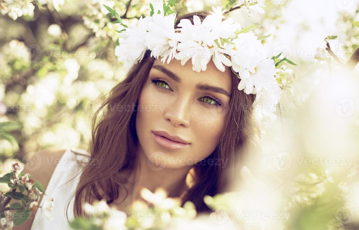Beautiful woman with green eyes in the garden of apple photo