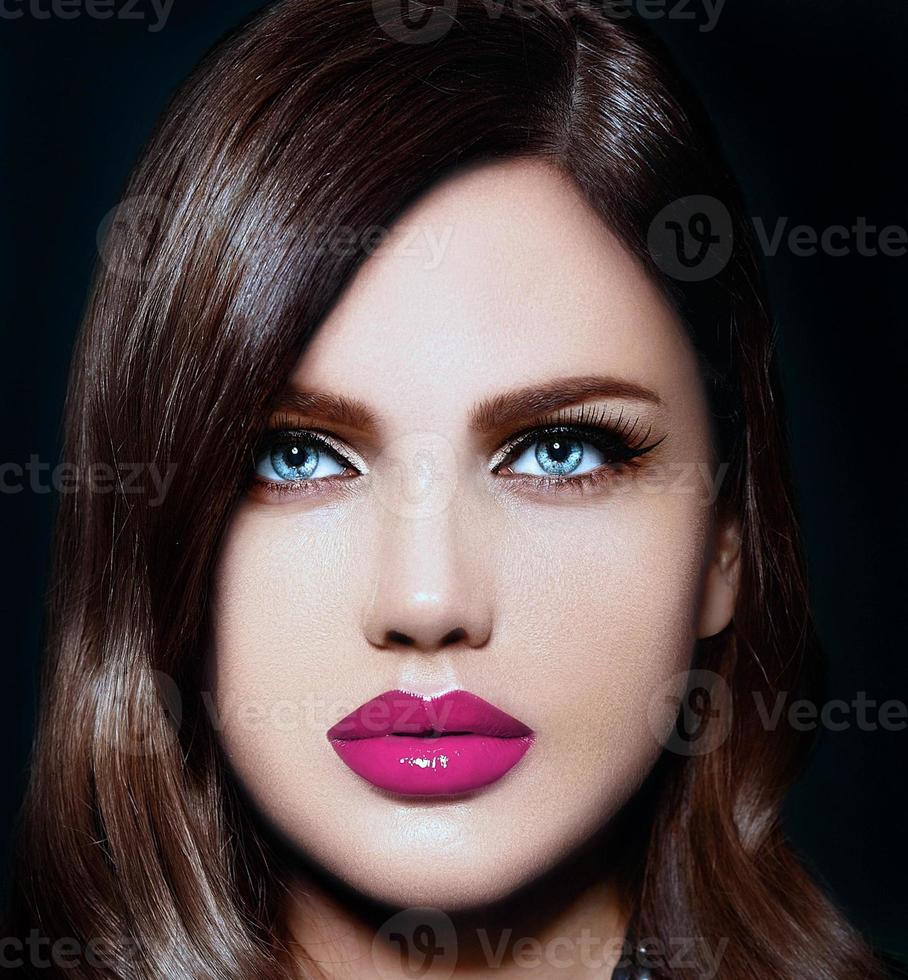 closeup portrait of beautiful woman model with pink natural lips photo
