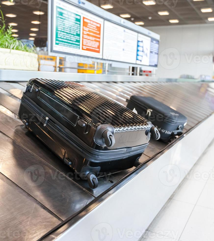 Baggage on conveyor belt at the airport photo