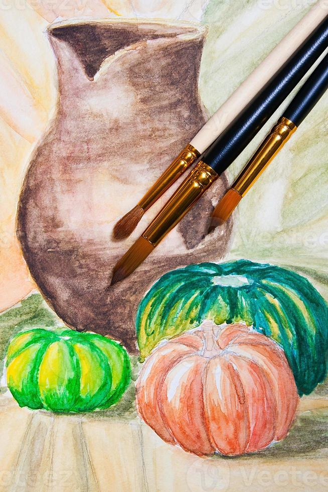 Paint brushes with watercolors painting. photo