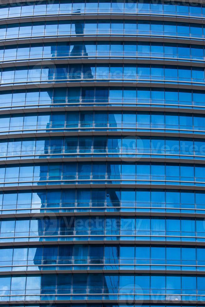 Reflextion in modern blue glass of office windows photo