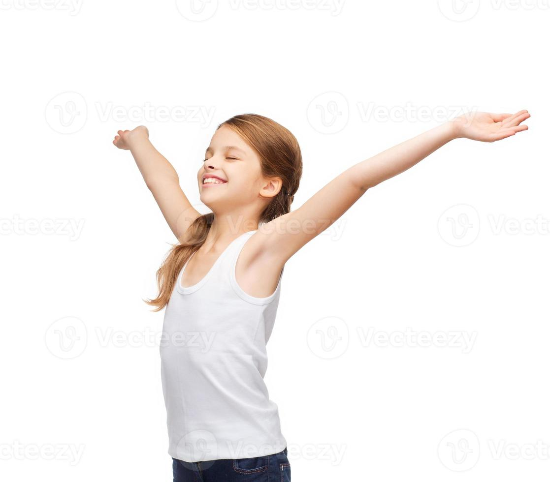 smiling teenage girl with raised hands photo
