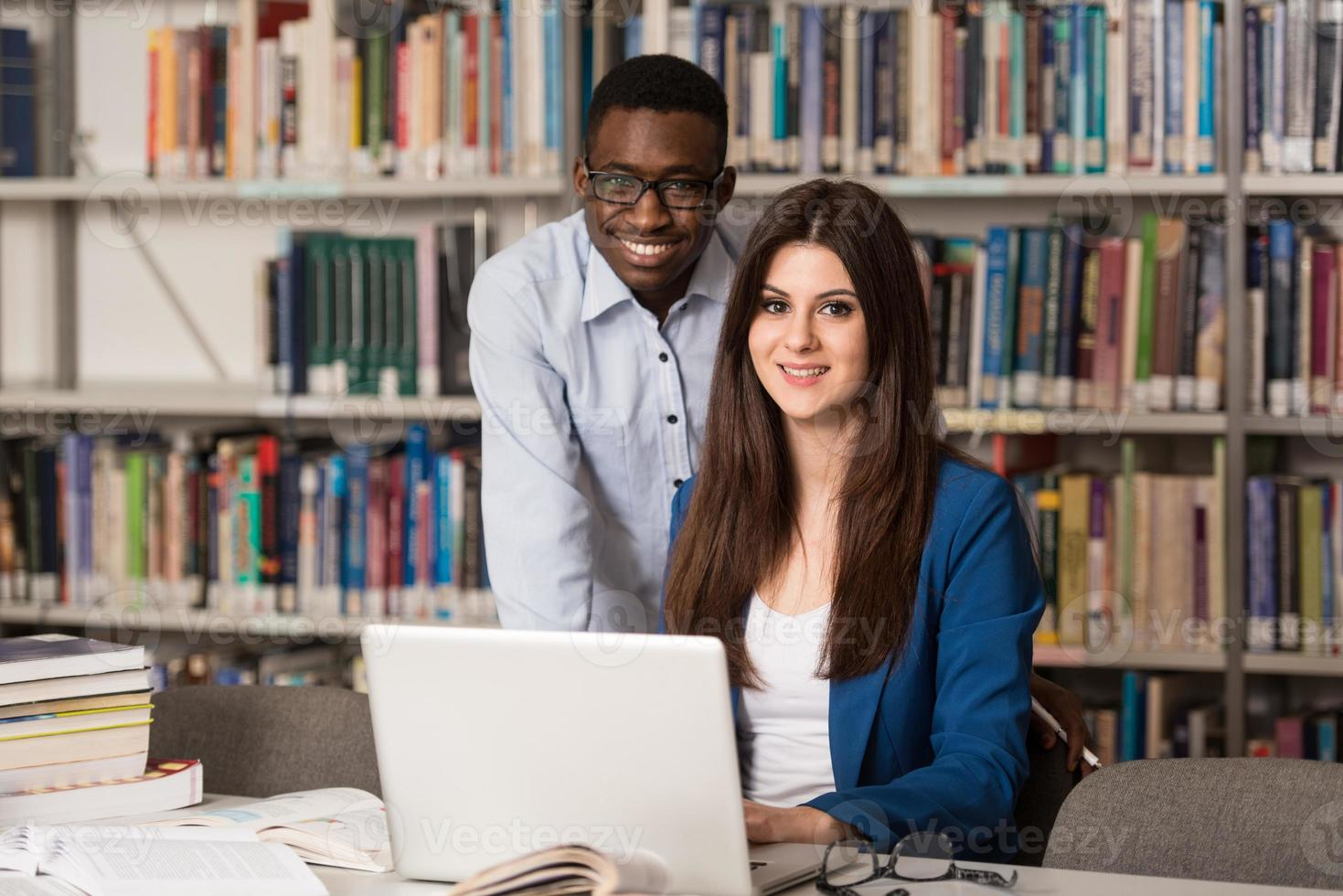Couple Of Students With Laptop In Library photo