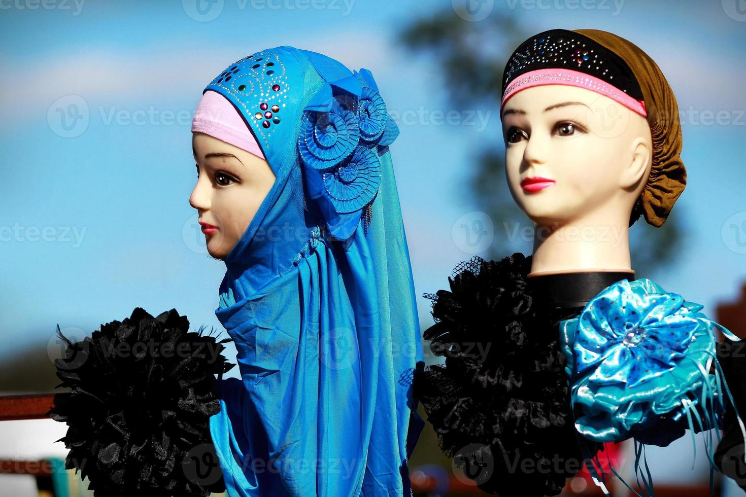 Indian asian mannequin with headscarf jewellery at culture festival market photo