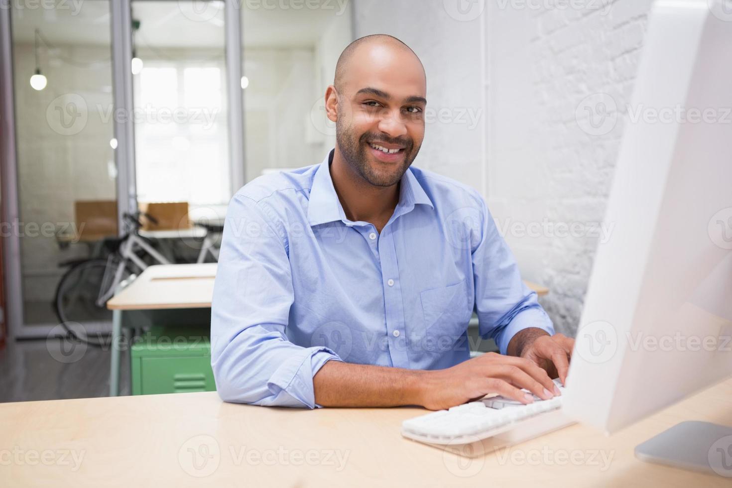 Businessman using computer at desk photo
