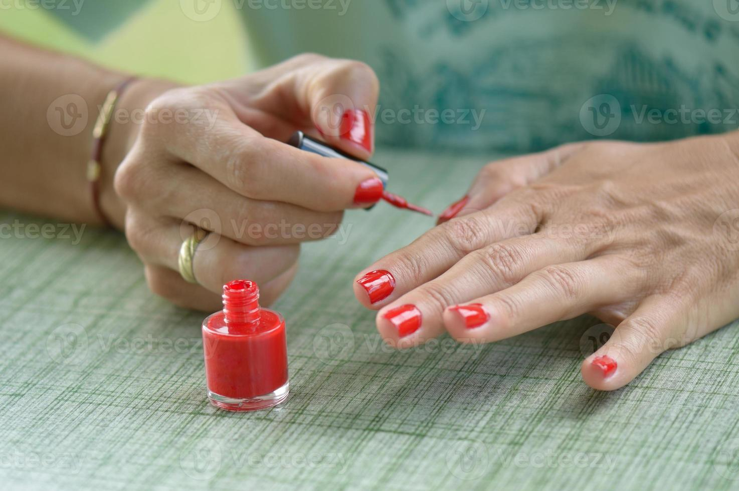 Woman Red Nail Polish photo