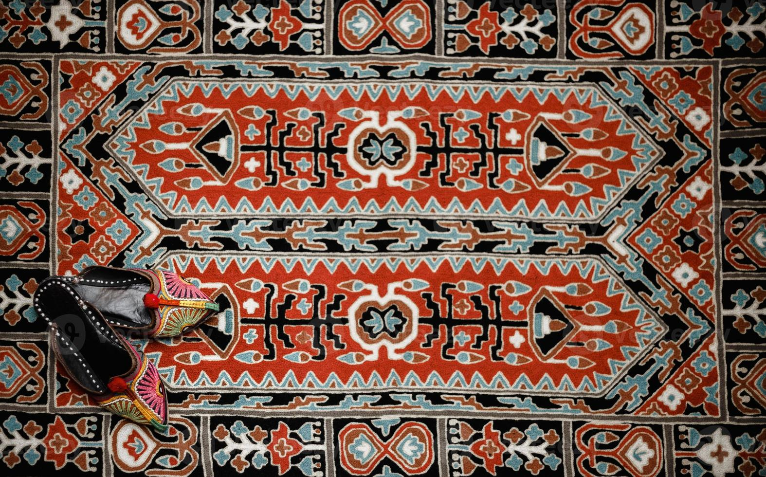Asian interior. Carpet and slippers photo