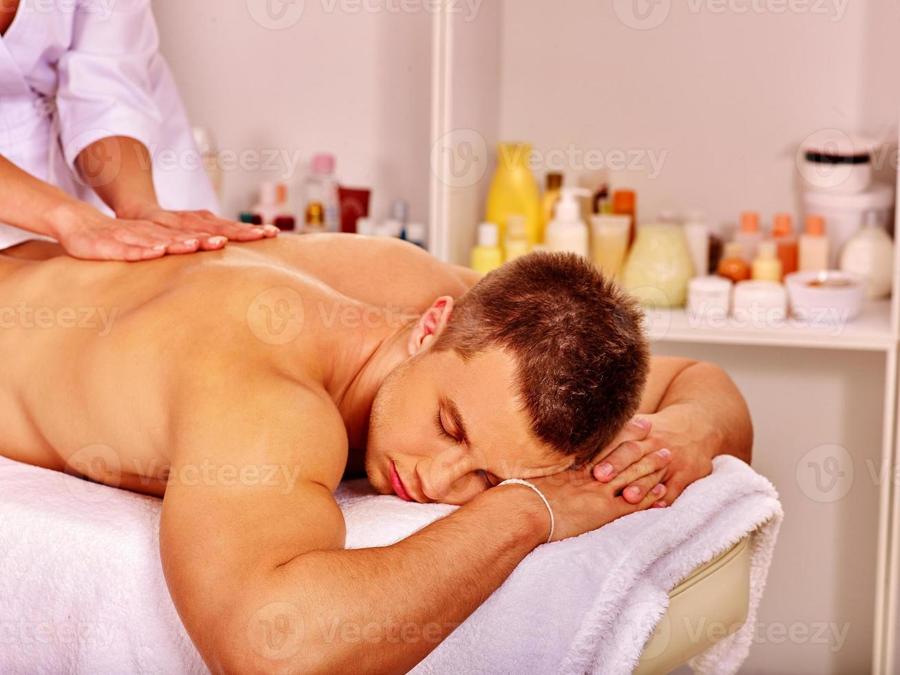 Man getting massage in spa photo