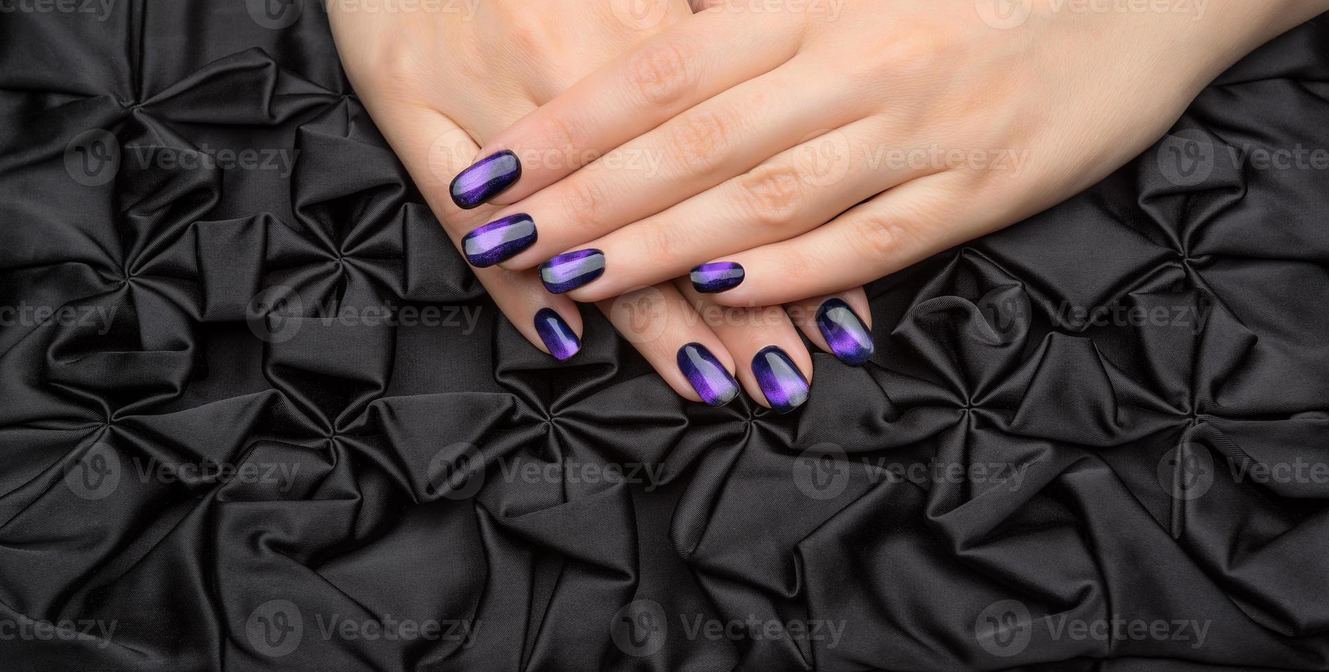 Beautiful woman's nails with nice stylish manicure. photo