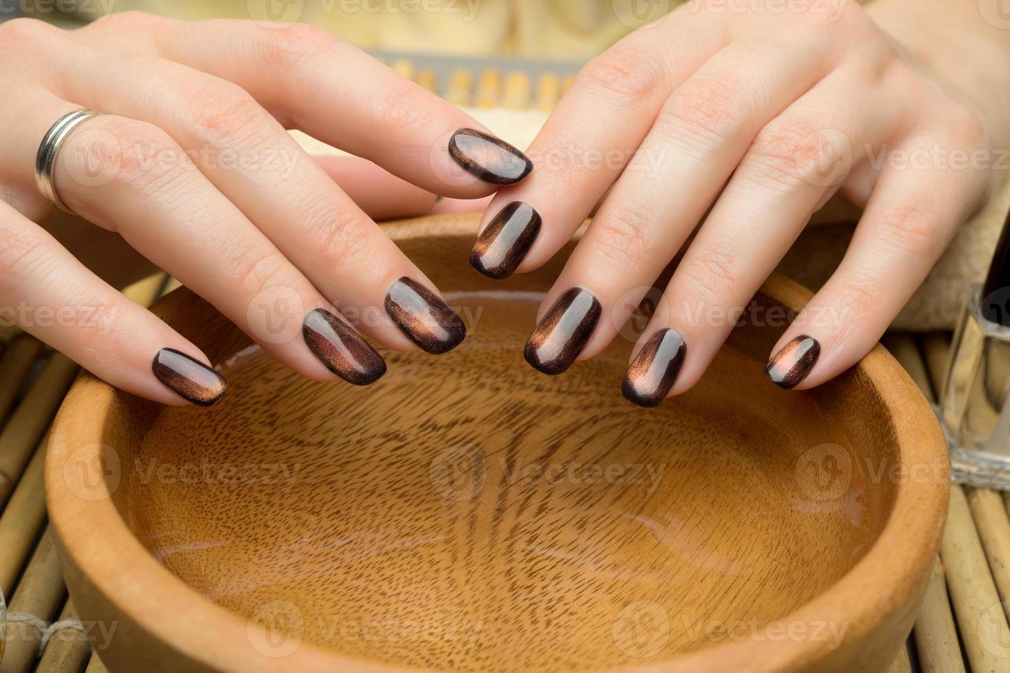 Beautiful woman's nails with nice stylish manicure photo