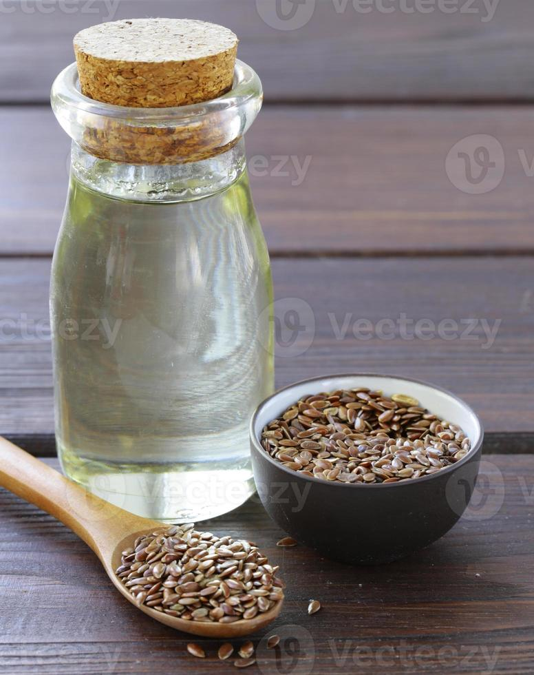 flax seed oil in glass bottle on a wooden table photo