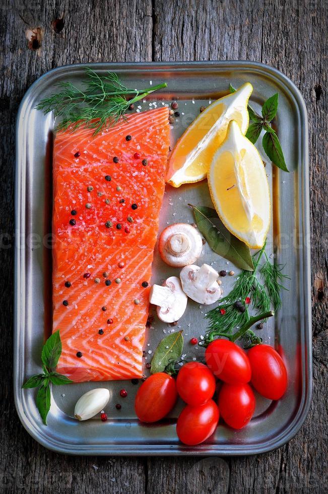 raw salmon fillet with cherry tomato, mushroom, dill, garlic photo