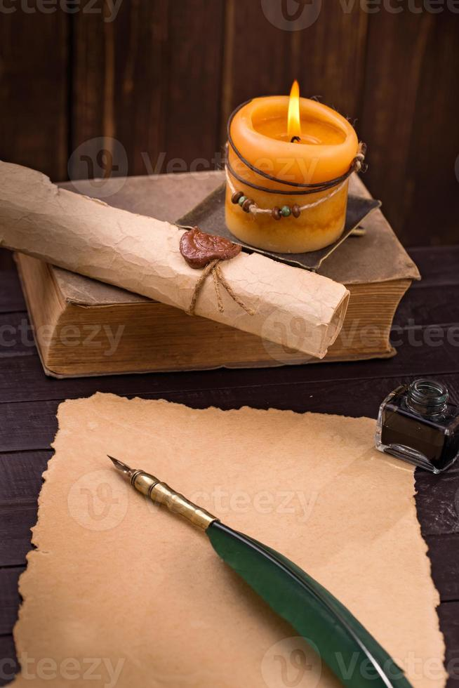 Old paper candle and quill pen photo