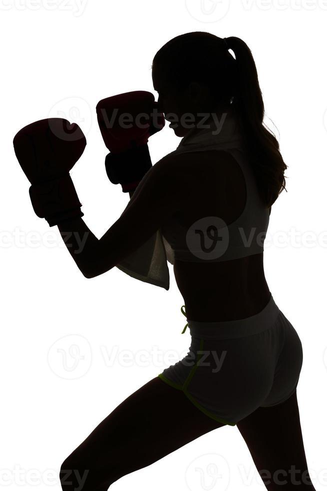 one caucasian woman boxing exercising in silhouette studio isola photo