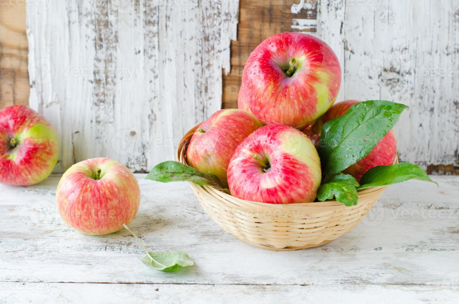 Red apples in a basket photo