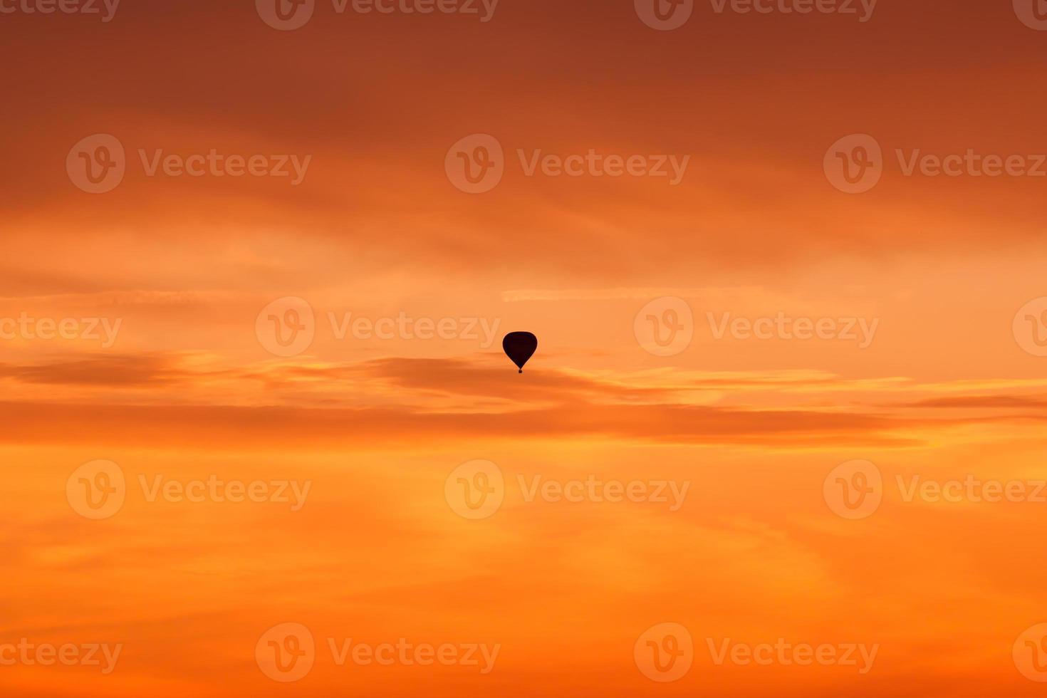 Hot air balloon flying at sunset sky photo