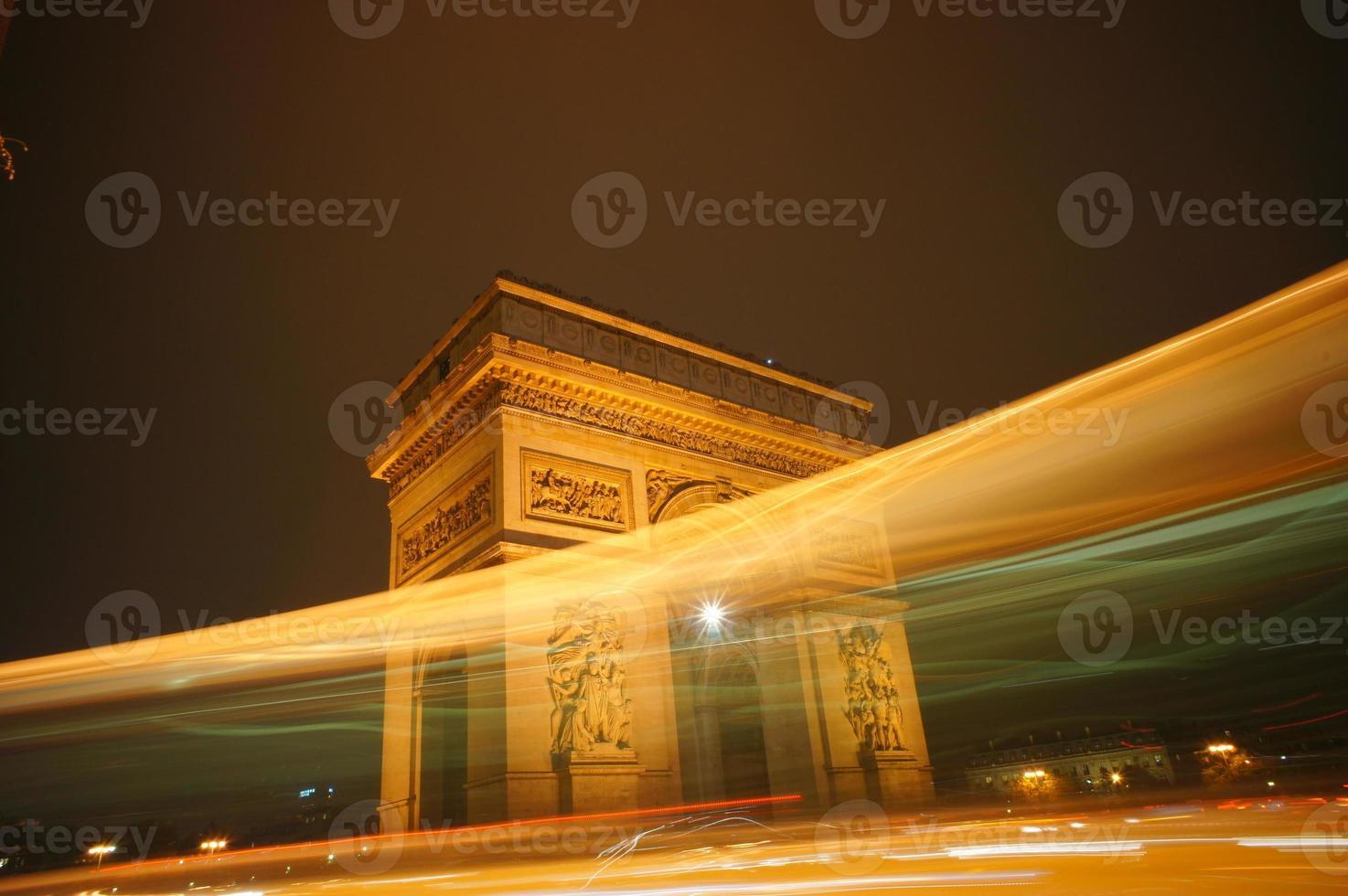 Illuminated Arc of Triumph in Paris city photo