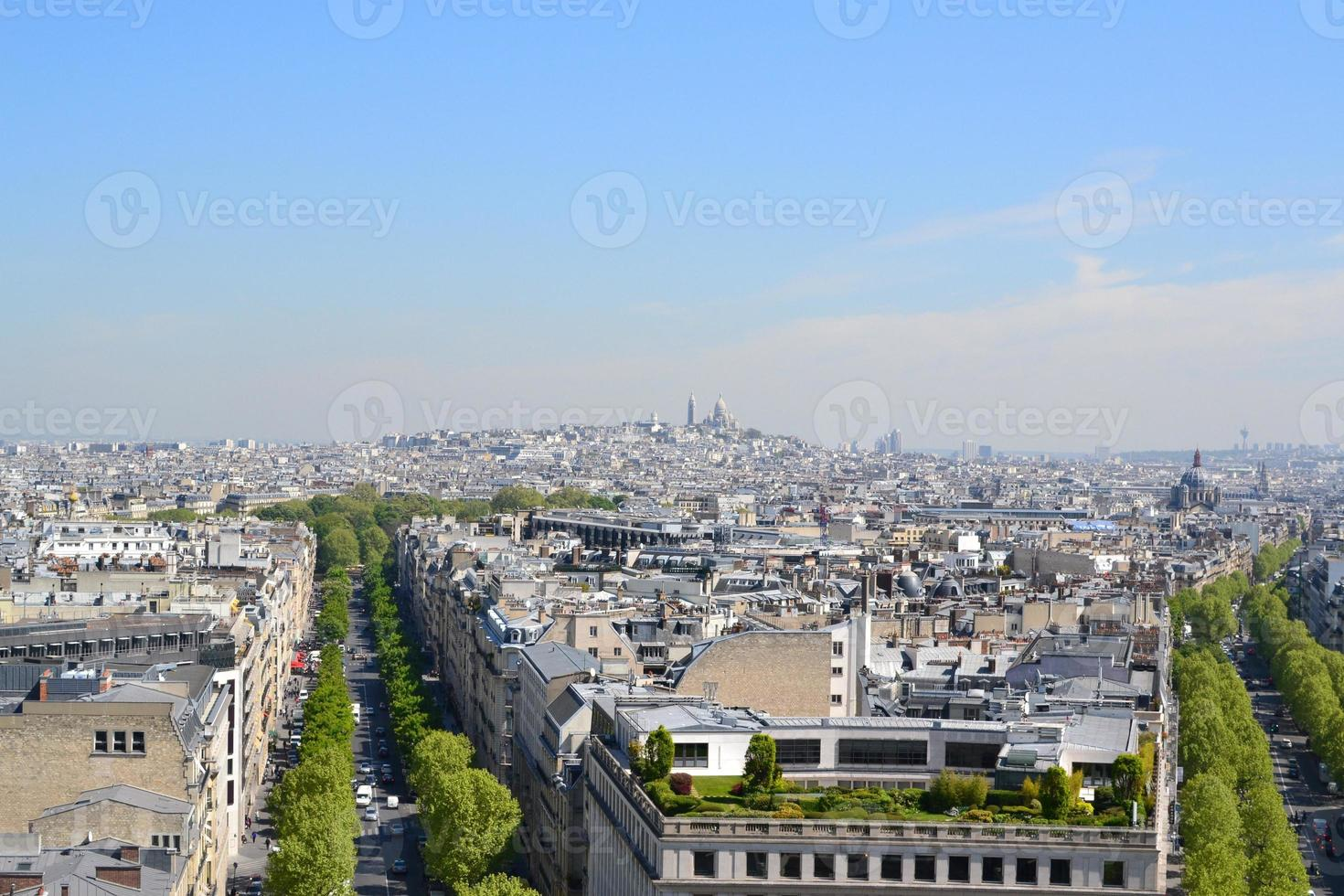 Sacre-Coeur and rooftops of Paris photo