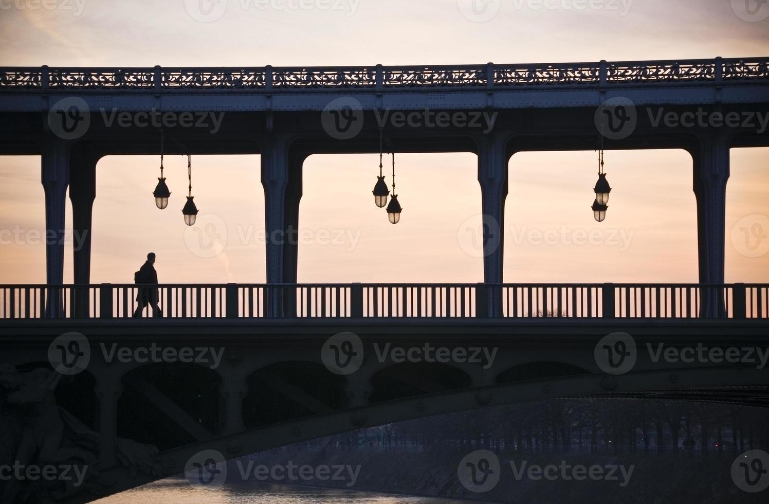 Man on a bridge photo