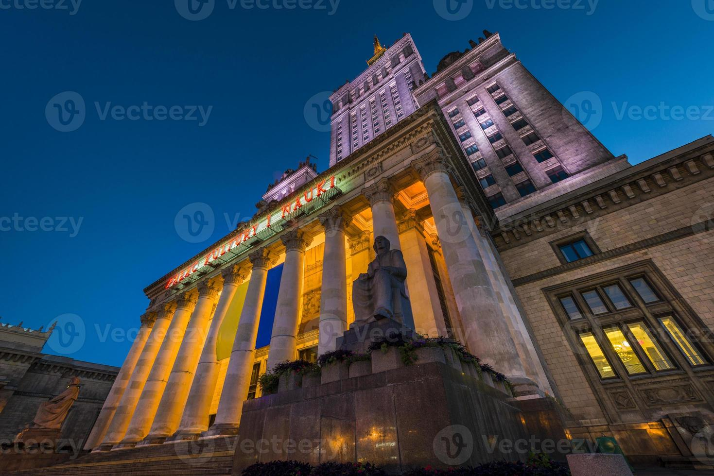 Palace of Culture in Warsaw at night time photo