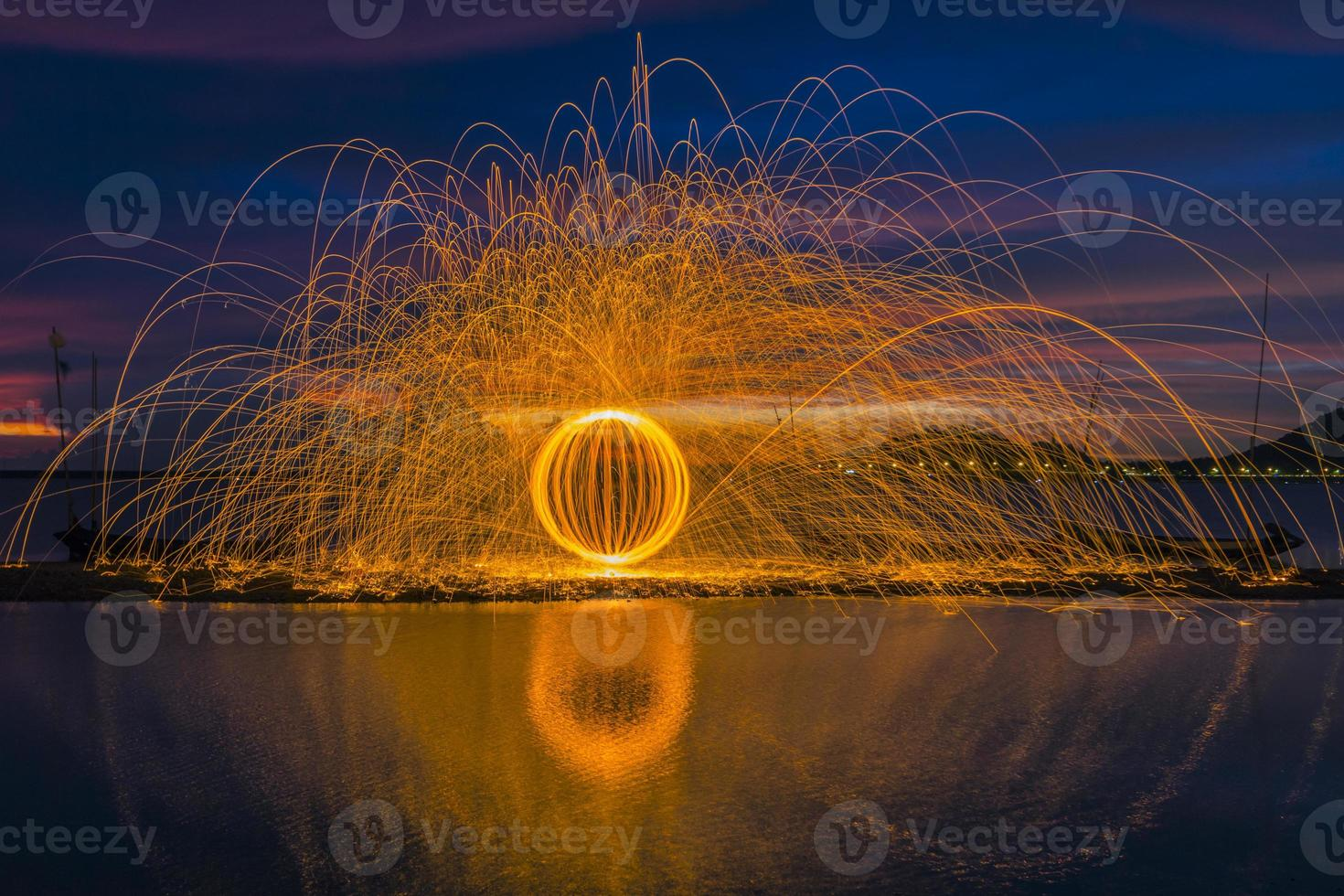 Firework showers of hot glowing sparks from spinning steel wool. photo