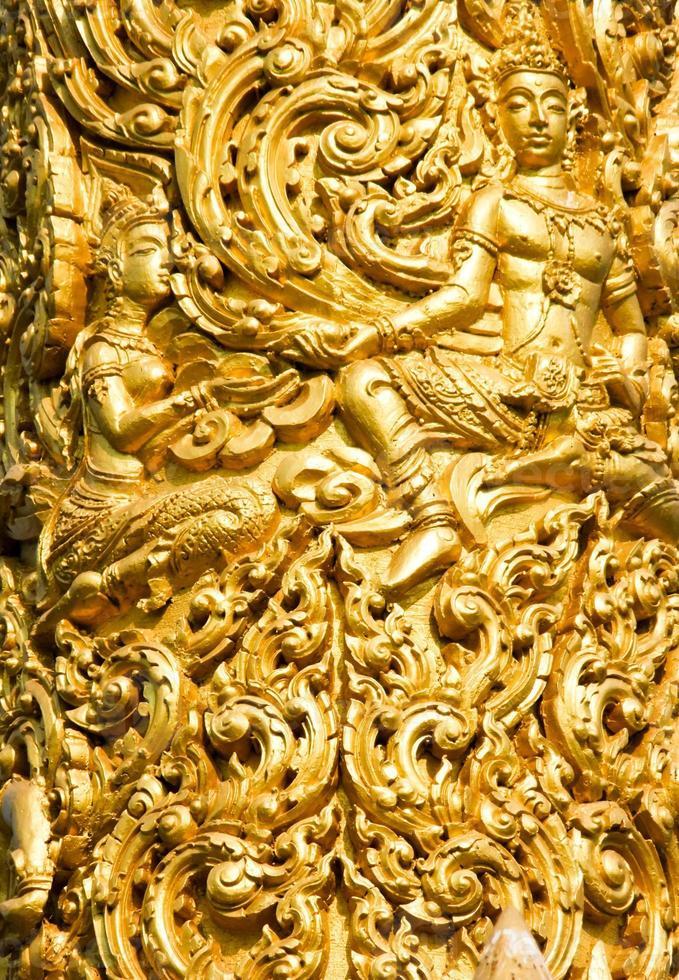 Close-up of Golden wax sculpture in Ubon Ratchathani, Thailand photo