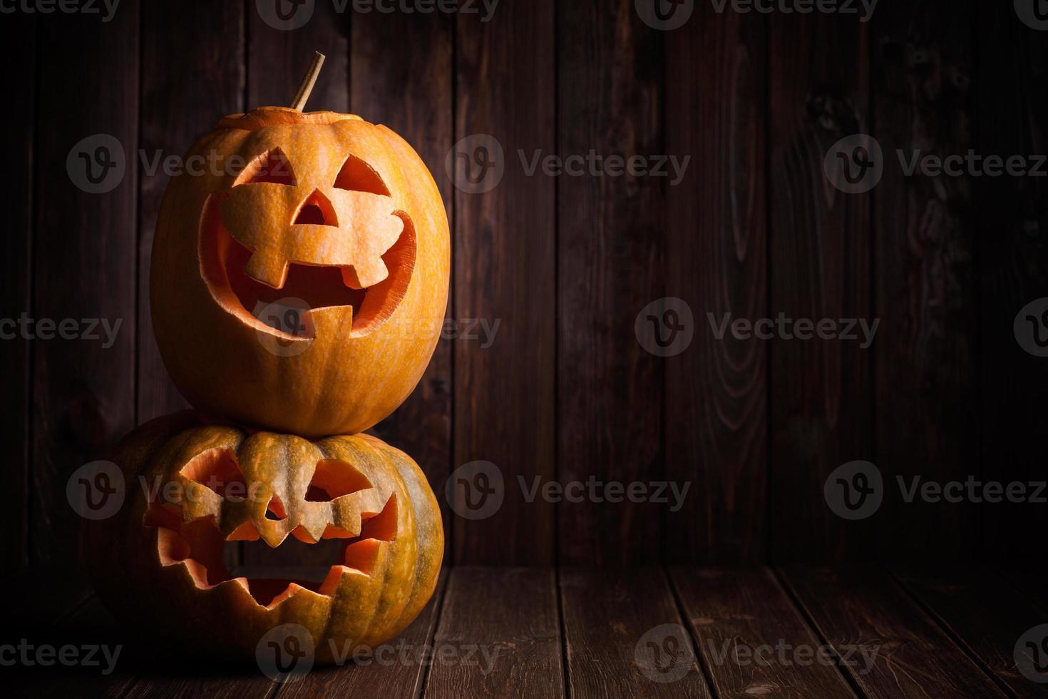 jack-o-lantern on wooden background photo