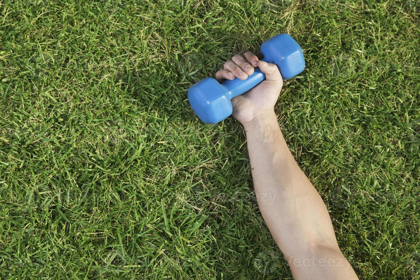 Arm with Blue Dumbbell photo
