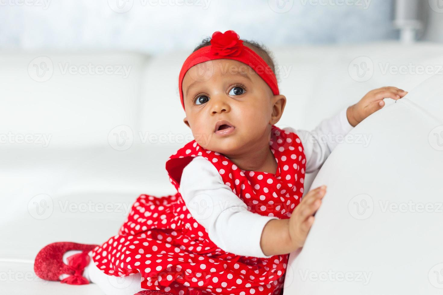 Portrait of little African American little girl playing - Black photo