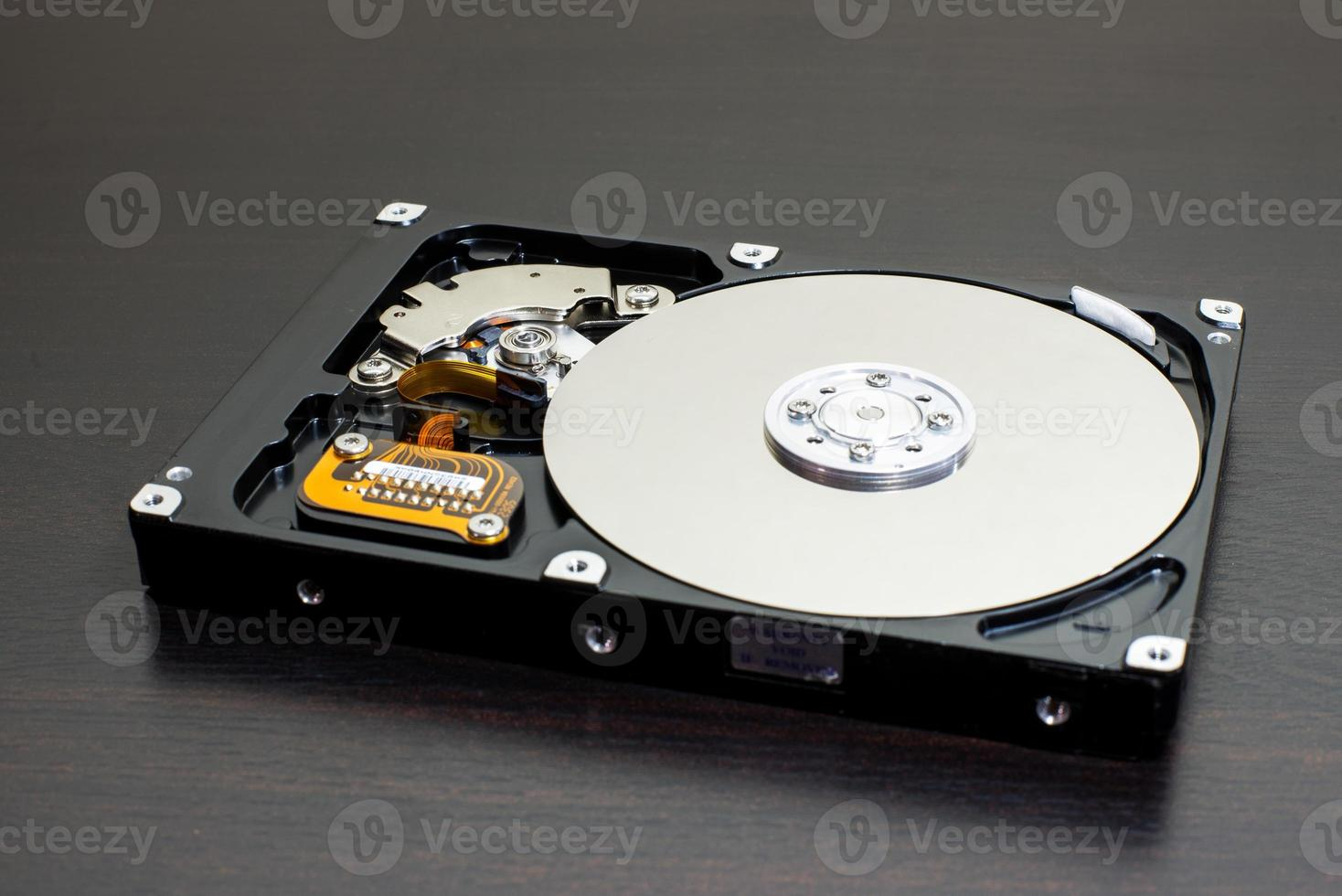 Close up of open computer hard disk drive (HDD) photo