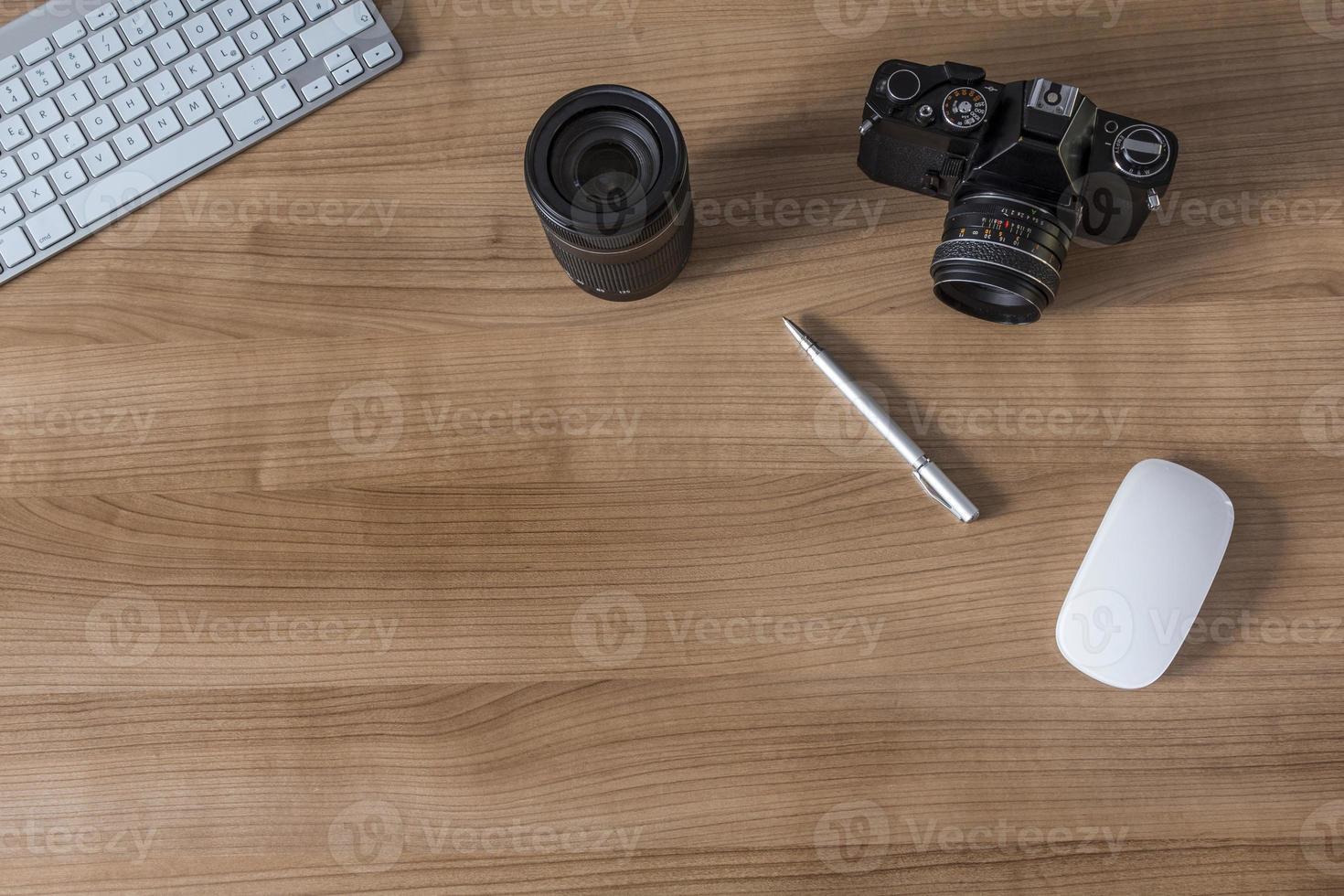 Desktop with modern keyboard and camera photo