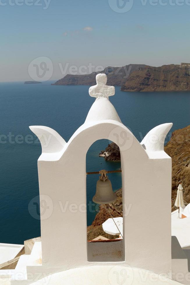 Traditional architecture of Oia village on Santorini island photo