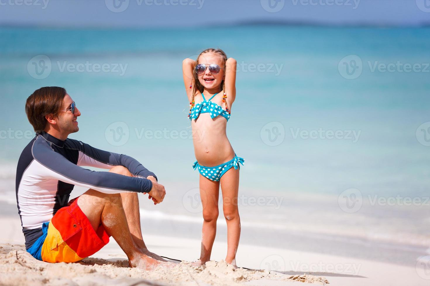 Father and daughter at beach photo