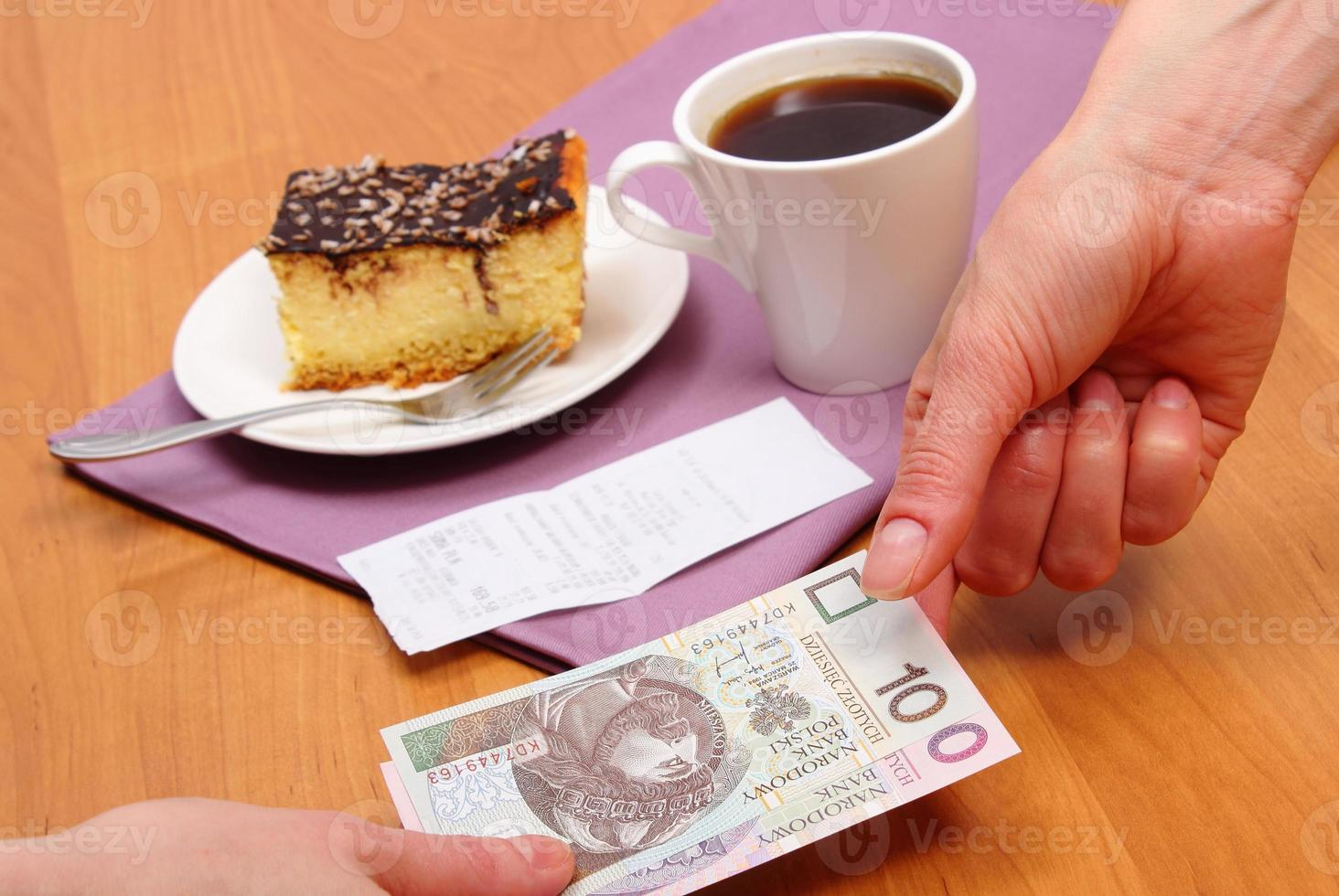Paying for cheesecake and coffee in the cafe, finance concept photo