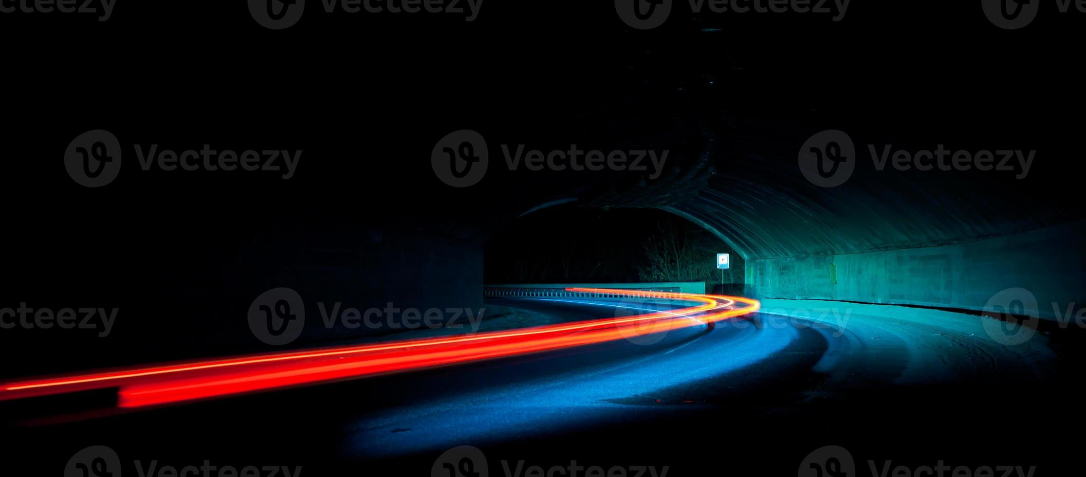 Car light trails in the tunnel photo
