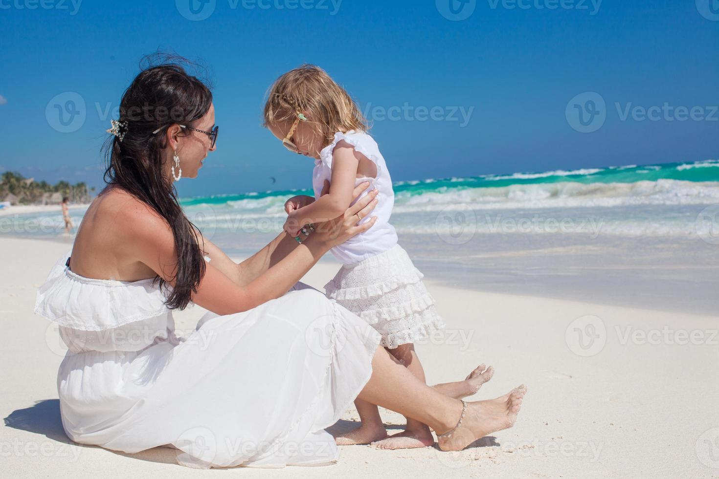 Back view of mother and little daughter enjoy vacation photo