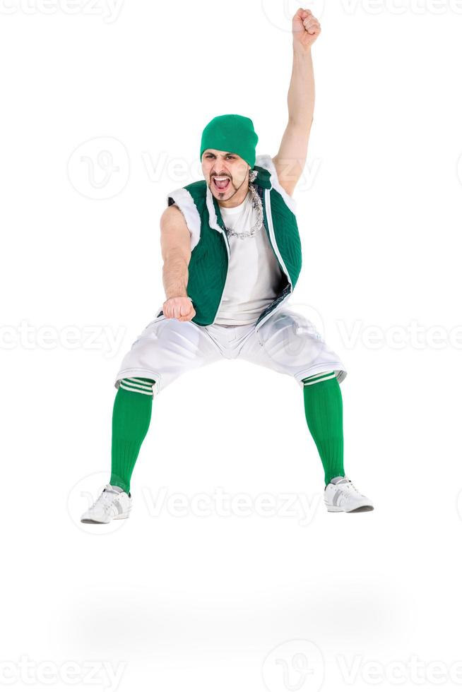 friendly man dressed like a funny gnome jumping Isolated on photo