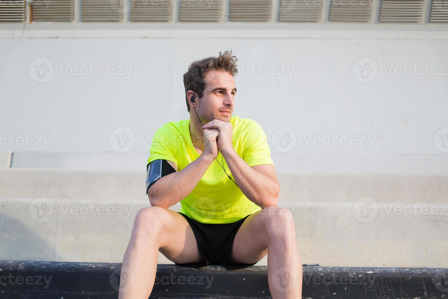 Satisfied his training athlete enjoying rest outdoors in summer day photo