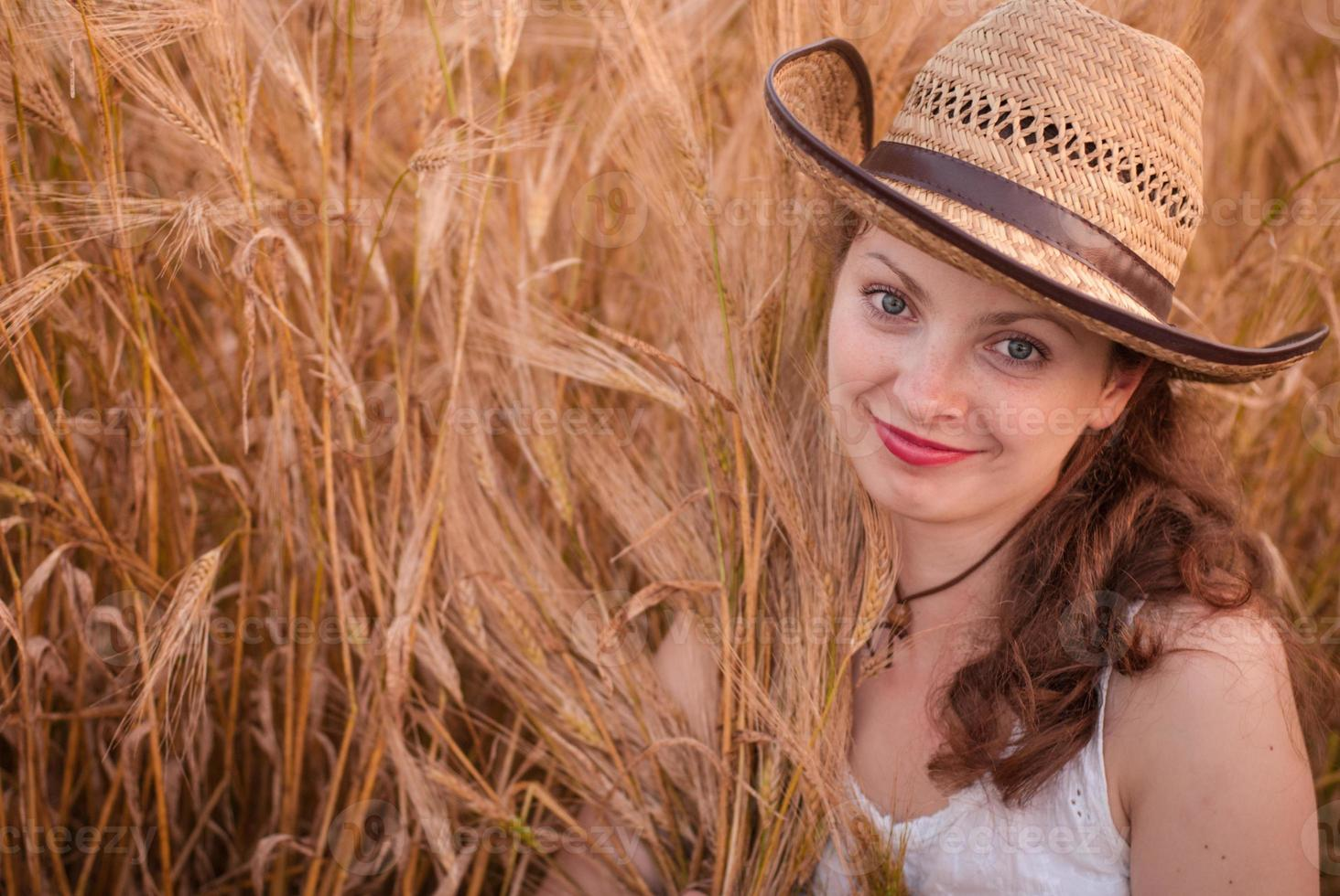 Woman in the wheat field photo