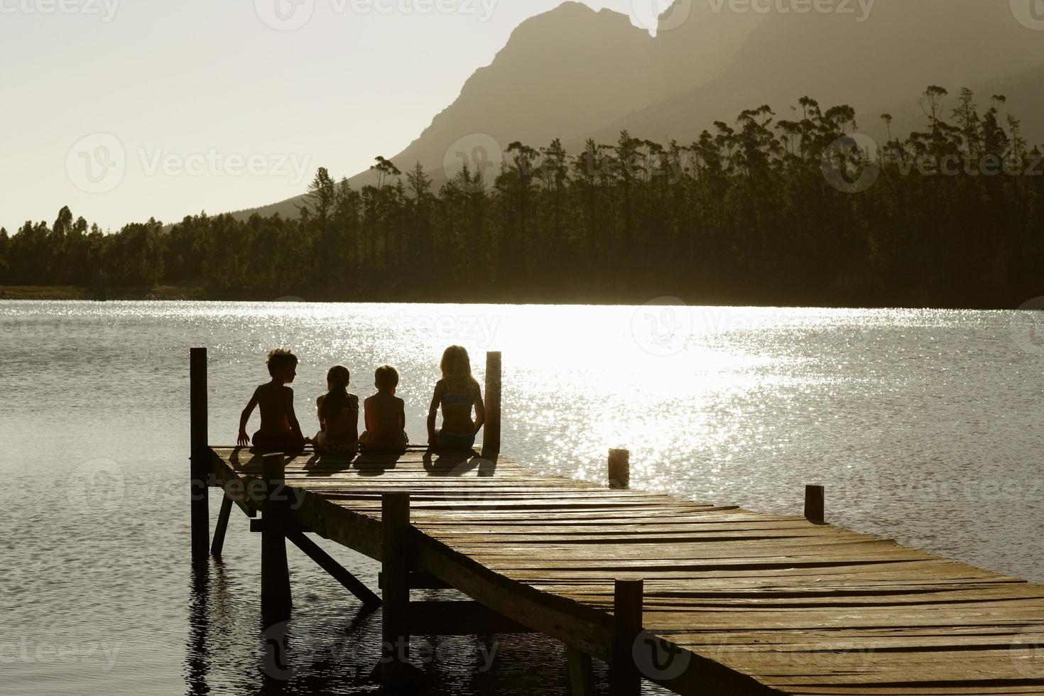 Kids Sitting on Dock photo