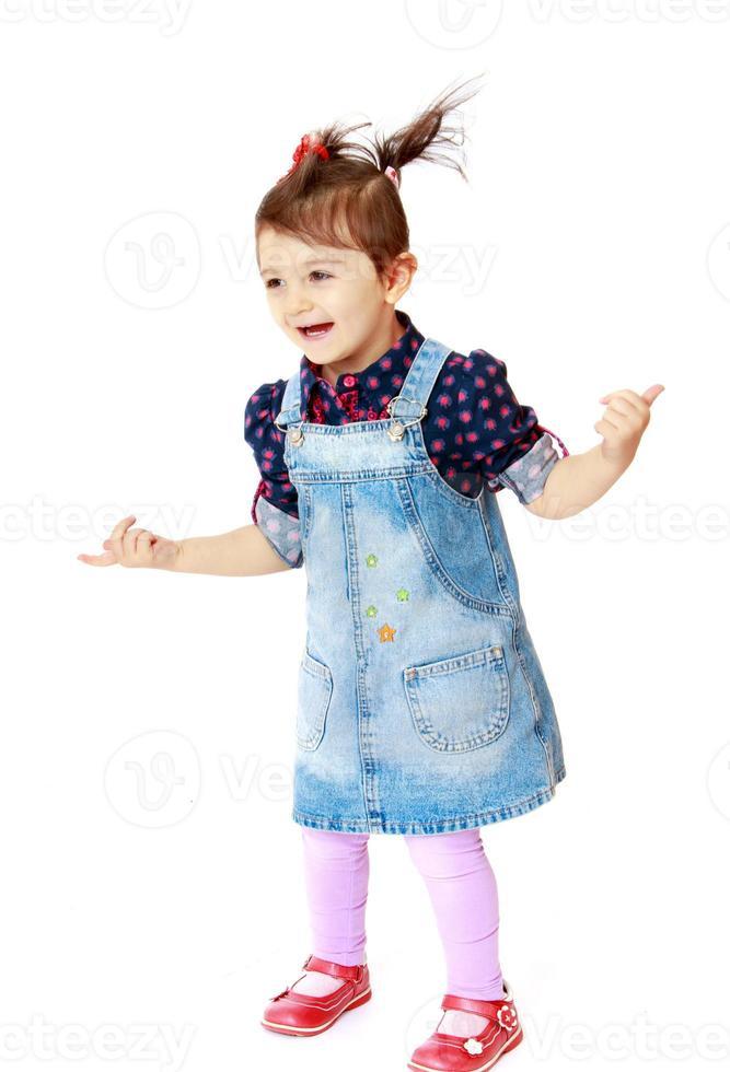 funny little girl waving hands photo