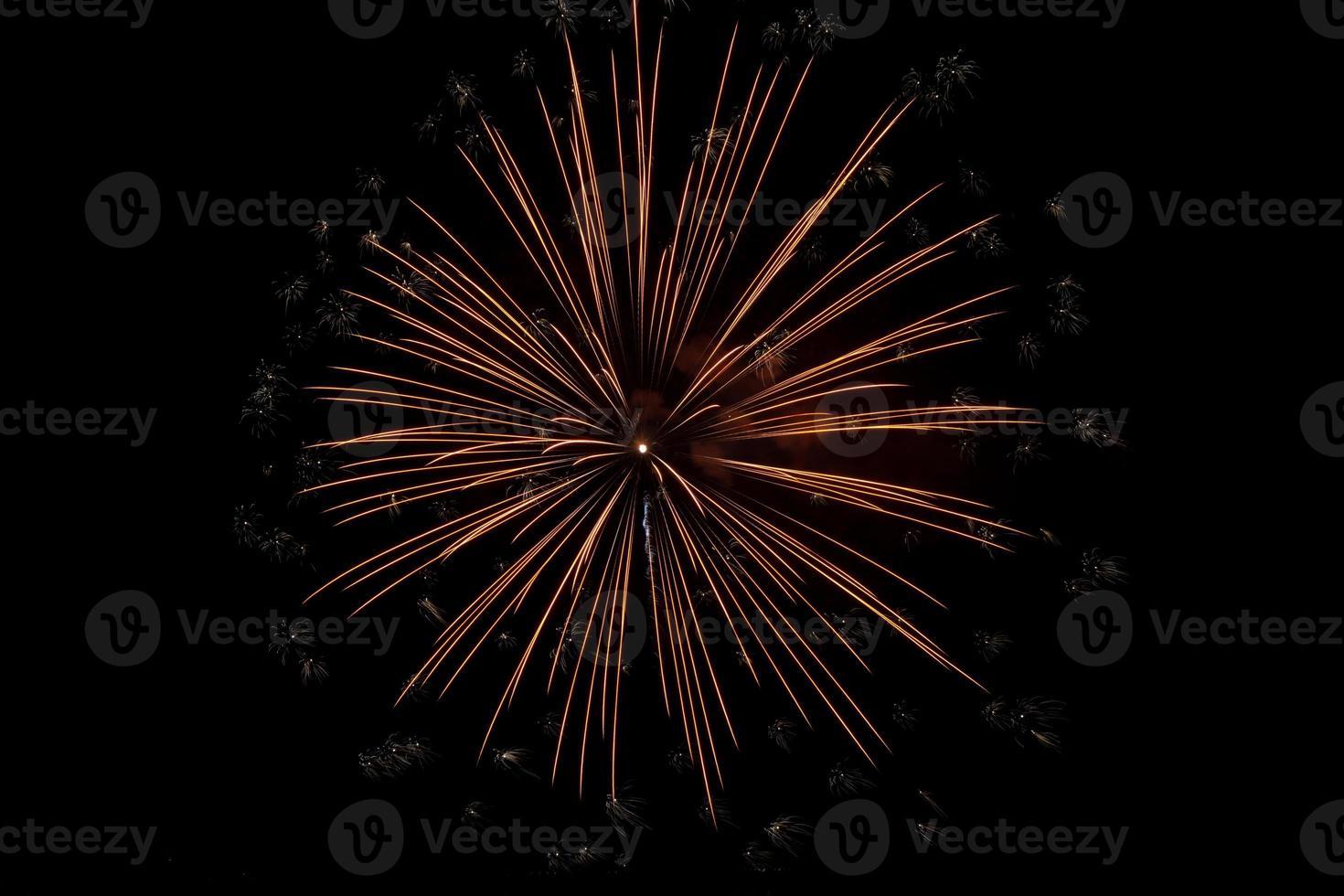 Colorful fireworks over dark sky photo