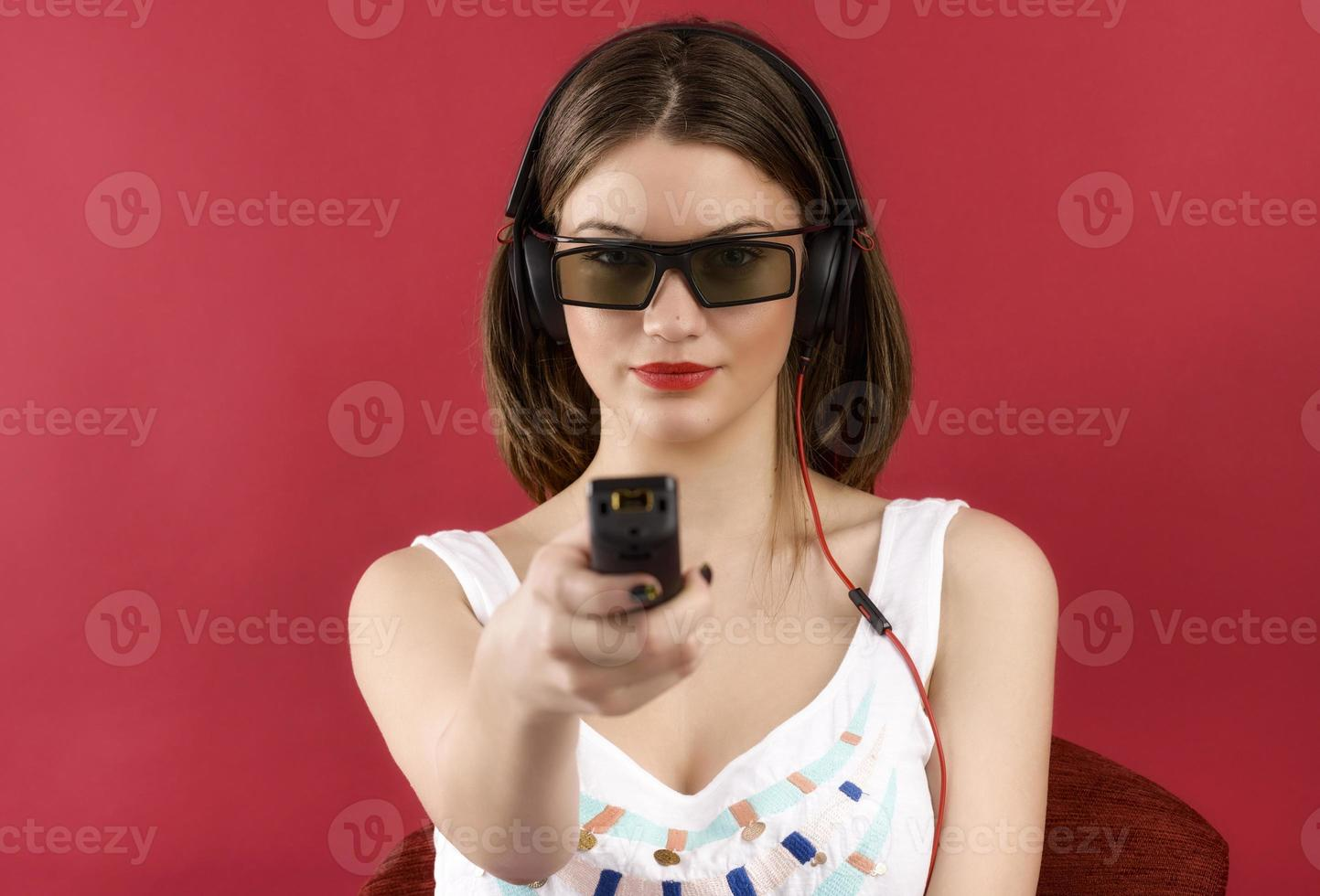 beautiful girl playing 3D video game isolated on red background photo