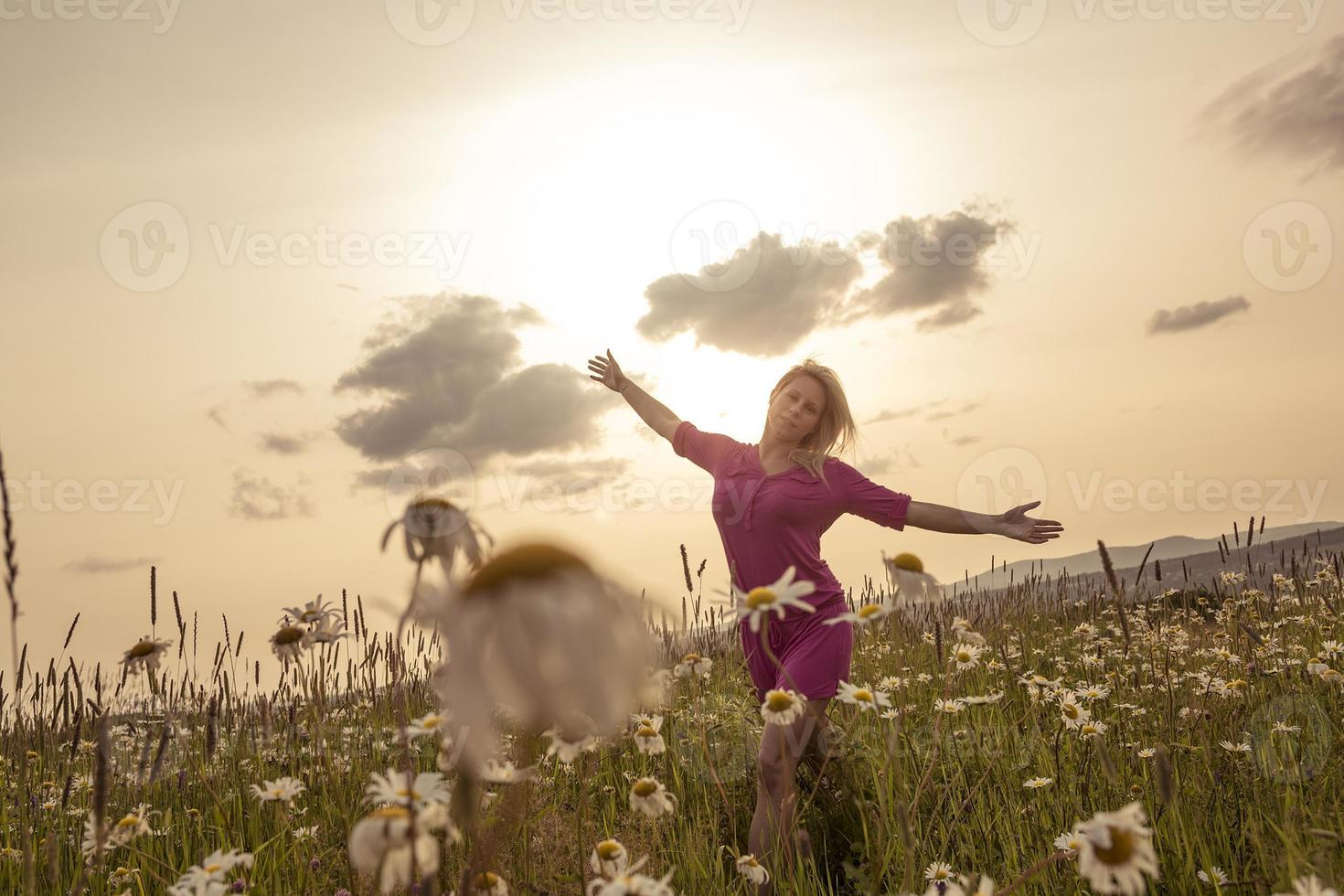 Photo of pretty blonde woman on a field
