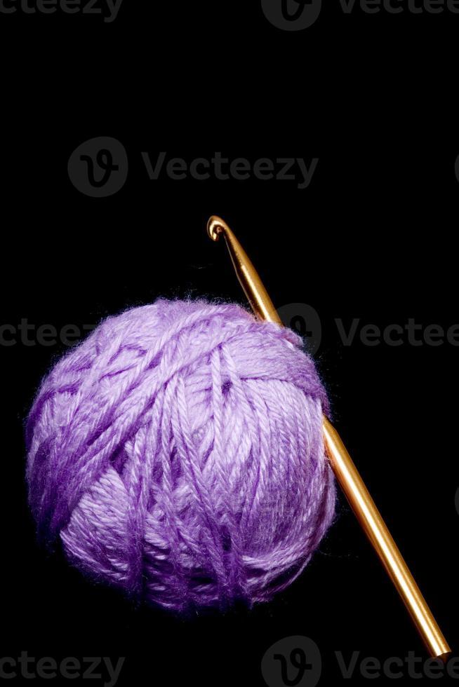 Crochet hook and yarn photo