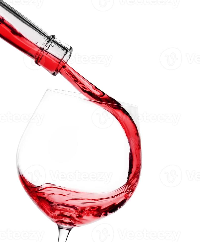 Red wine pouring down from a bottle photo